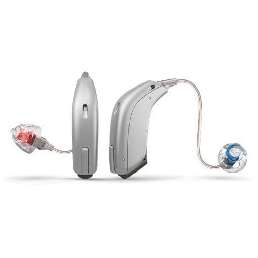 Small, silver coloured Oticon opn hearing aids