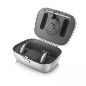 Small Unitron Moxi Jump Hearing Aids inside silver charging case