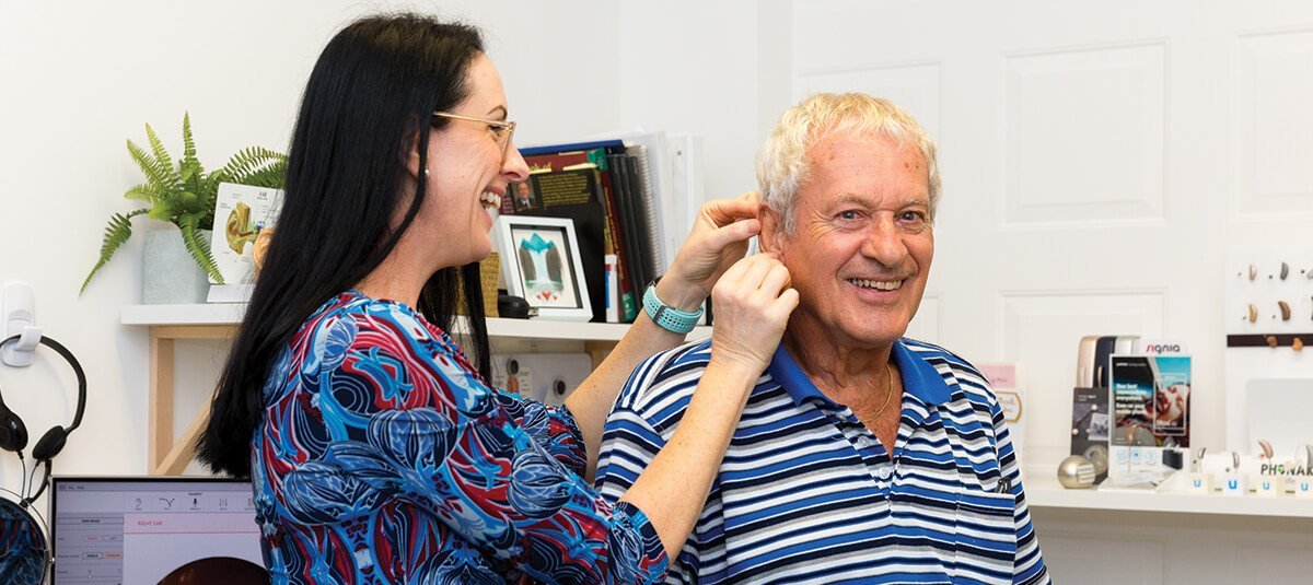 Hearing aid being fitted by Audiologist in Cleveland