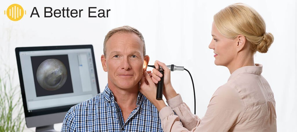 Audiologist carrying out hearing beep test of patients ear canal in Brisbane