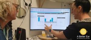 audiologist giving pensioner hearing test results in redlands, Queensland