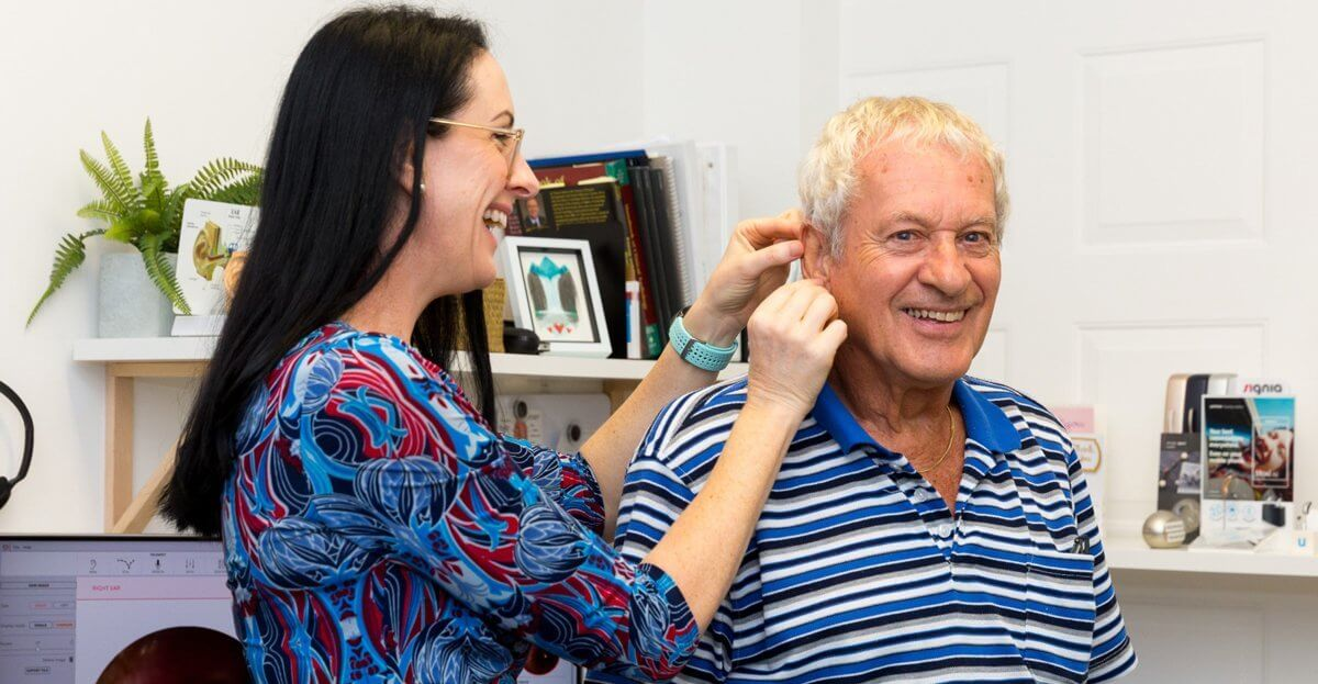 pensioner having hearing aids fitted in Redlands
