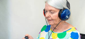 Lady sitting a hearing test | A Better Ear